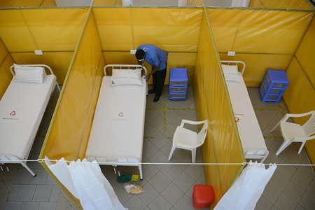 A health worker is seen mending a bed at the yet to be used  COVID-19 field hospital at The Aga Khan University Hospital in Nairobi, Kenya. The field hospital will be used to treat persons who test positive for the Coronavirus.