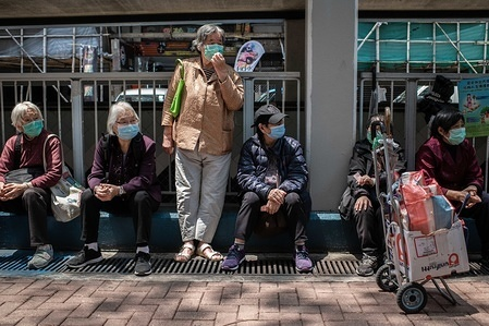 A group of elderly people wait in queue to receive a free meal, during the pandemic. As the coronavirus pandemic worsens, thousands of Hong Kong residents who live in cramped coffin homes or homeless situation are struggling to adjust to their new reality. Coronavirus cases in Hong Kong cross the 900 mark.