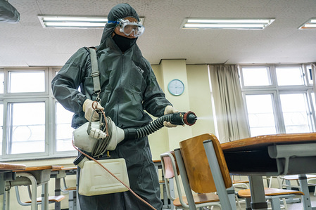 A worker wearing protective gear disinfects a classroom as they prepare to reopen the school. South Korean authorities announced that schools will start reopening from Wednesday, May 13, after holding online classes for several weeks due to the coronavirus outbreak. 3rd grade students in High school will be the first to go back to school on May 13, followed by younger pupils who will gradually return between May 20 and June 1.