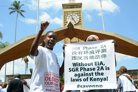 Protesters are seen outside   Parliament buildings in Nairobi during a demonstration against the construction of the second phase of standard gauge railway through the Nairobi National Park. Conservationist are against the construction citing the negative impact it will have at the park.
