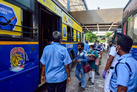 Traffic officers count passengers entering in a bus at a bus station amid coronavirus crisis.