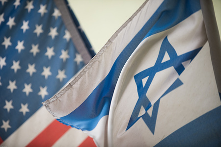 An United States of America and Israel flags seen at the Jewish quarter in Krakow.