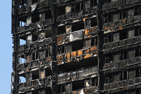 The charred remains of the tower block during the aftermath. A fire caused by an electrical fault in a refrigerator, broke out in the 24 storey Grenfell Tower block of flats in North Kensington, West London where 72 people died, more than 70 others were injured and 223 people escaped.
