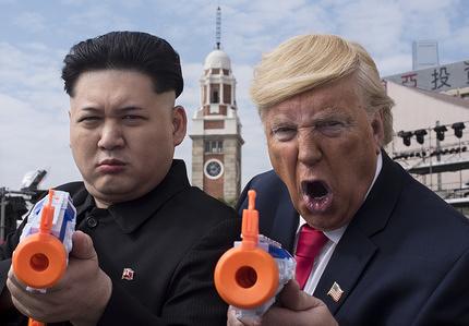 Kim Jong-un impersonator Howard and Donald Trump lookalike Dennis Alan seen together in Tsim Sha Tsui, Hong Kong.