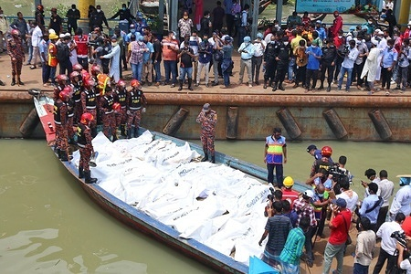 (EDITOR'S NOTE: Image depicts death) Recovered bodies of launch capsize victims collected from Buriganga River. At least 30 people died and a dozen are missing after a ferry capsized and sank on June 29 in the Bangladeshi capital Dhaka following a collision with another vessel, rescue officials said.