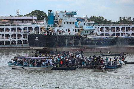 Members of coast guard join the rescue operation as a launch named 'Morning Bird' sank near the Farashganj ghat of Buringanga in Dhaka.