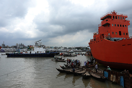 Rescue teams in action during operations. Fire Service, Navy, Coast Guard, River Police and BIWTA personnel conduct rescue operations for the second day after a fatal collision between two launches on Dhaka's Buriganga River that resulted in the deaths of currently 33 people after divers found another body.