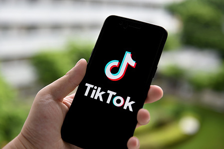 In this photo illustration a TikTok logo is seen displayed on a smartphone.