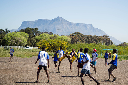 People are seen playing football at a refugee camp in Cape Town. Due to xenophobic violence, many foreign nationals have been relocated to camps in Kensington and Bellville by the city of Cape Town as the Covid-19 pandemic gripped the country.