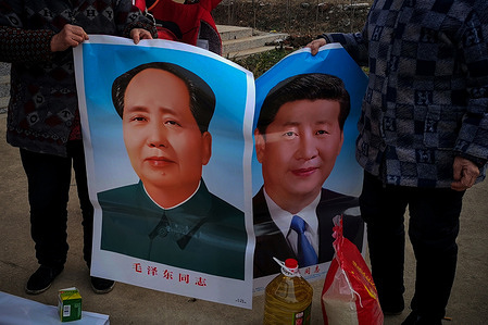 People seen holding Portraits of Xi Jinping and Mao Zedong in Anhui. Many people in China are very respectful to Xi Jinping and Mao Zedong. Especially in the countryside, people are willing to post pictures of Xi Jinping and Mao Zedong at home as a respect to the country's leaders.