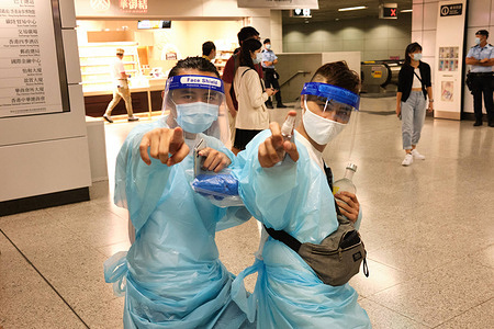 Participants dressed in personal protective equipment during Halloween. Revellers take part in a Halloween street party in Lan Kwai Fong amid the Covid-19 pandemic.