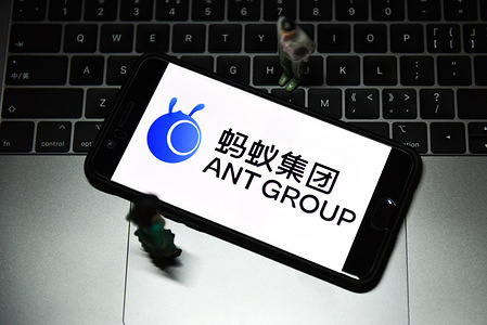 In this photo illustration an Ant Group logo seen displayed on a smartphone. Ant Group's highly anticipated IPO has been suspended following a meeting between the company's billionaire co-founder Jack Ma and regulators in China, an abrupt move that threatens what was due to be the largest share sale in history.