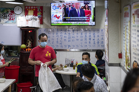 At a local restaurant, the Republican candidate Donald J. Trump appears on TV during news report about the US presidential election.