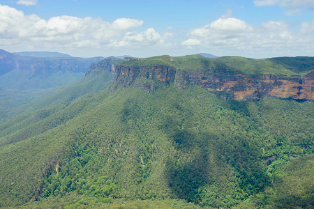 A view of the mountains. The Blue Mountains is a mountainous region located in New South Wales. It offers some of the most iconic views in the National Park. One of the must see tourist spot in Sydney.
