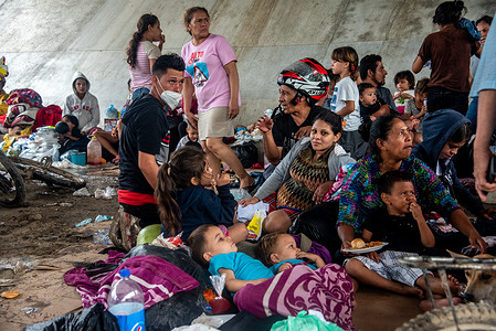 People who were forced to abandon their homes in the San Pedro Sula Valley due to floods in the aftermath of Hurricane Eta take refuge in a makeshift camp underneath an overpass in Chemelecon. Three days after Hurricane Eta hit the Nicaraguan coast as a Category 4 storm, the aftermath of flooding and mudslides has displaced over 350,000 Hondurans. The death toll in Central America is over 100 and expected to rise because of many missing people