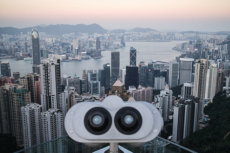 A telescope at Victoria Peak, a typically busy tourist attraction.