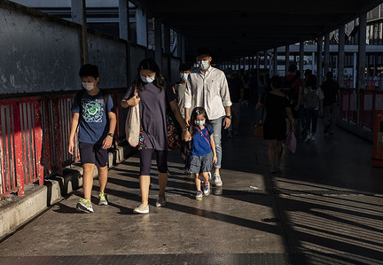 A family wearing face mask as a precautionary measure against the COVID-19.