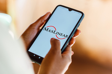 In this photo illustration the MaxLinear logo seen displayed on a smartphone.