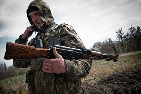 A DNR soldier seen in a look out post at the front line in the city of Horlivka. 24th Apirl 2015