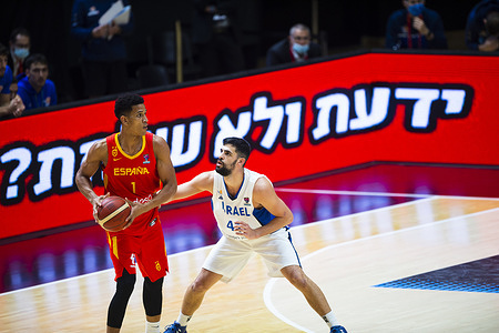 Jose Miguel Perez Babuena of Spain and Tomer Ginat of Israel in action during the FIBA EuroBasket 2022 Qualifiers match between Israel and Spain at Pavelló Municipal Font de San Lluís (Pabellón Fuente de San Luis). Final score; Israel 95:87 Spain.