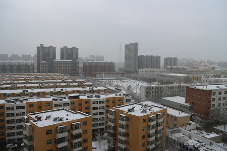 A residential community in the outskirts of Yinchuan seen covered in snow.