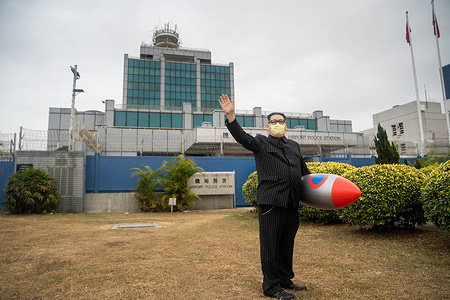 North Korean leader Kim Jong Un impersonator Howard X poses with his inflatable rocket before heading inside the police station for reporting his bail. Howard X from Hong Kong who is well known for being the impersonator of the North Korean Leader Kim Jong Un was arrested by the Hong Kong police in October for possession of arms without license, he was later releases on bail with the condition of having to report to the police station once every 6 weeks.