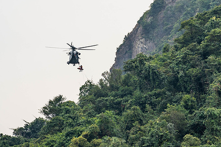 A Hong Kong Government Flying Service Airbus H175 helicopter (Registration: B-LVG) seen during a recue mission to provide medical assistant to an injured rock climber who has fallen off the cliff at Central Crag.