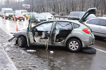 View of a crashed car on Peremohy Avenue Roadway in Kiev. In Kiev, due to deteriorating weather conditions, an ice cover has formed. As a result, there has been a significant increase in pedestrian fracture related injuries and an increase in the number of accidents.