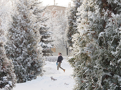 A man walks through a snow-covered Park. Frosty Sunny Day in the Moscow region.