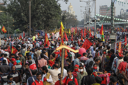 Thousands of protesters hold flags during the demonstration. Activists of AIKSCC (All India Kisan Sangharsh Coordination Committee) staged a protest against the newly imposed Farm bill by the central government of India. Thousands of farmers, Students and activists from different places of West Bengal took part in this protest to support the farmers' movement in Delhi.