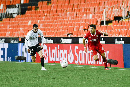 David Remeseiro Salgueiro (Jason) of Valencia and Marcos Acuna of Sevilla are seen in action during the Spanish La Liga football match between Valencia and Sevilla at Mestalla Stadium. (Final score; Valencia 0:1 Sevilla)