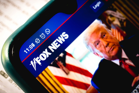 In this photo illustration the close-up of the Fox News Channel website seen displayed on a smartphone.
