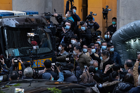 Journalists take pictures of a Correctional Services Department vehicle going to carry pro-democracy media tycoon Jimmy Lai following a ruling sending him back in custody.  Hong Kong's Court of Final Appeal has revoked Lai's bail after prosecutors succeeded in asking the court to return him to custody.
