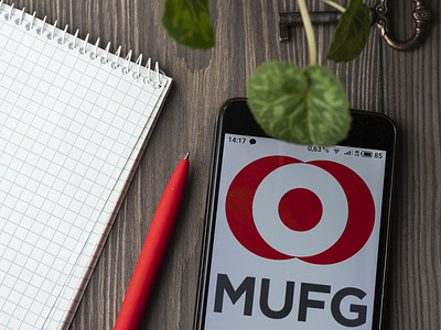 In this photo illustration a Mitsubishi UFJ Financial Group logo seen displayed on a smartphone.
