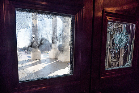 A view of a damaged window in an external door on the second floor of the Capitol, as part of the damage from the protest.