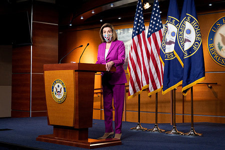 House Speaker Nancy Pelosi (D-CA) wearing a face mask speaks at her weekly press conference.