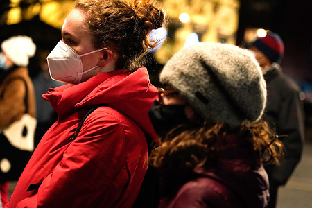 Demonstrators wearing face masks listen to speakers in Union Square during the protest.Speakers highlighted the countries fascist tendencies as well as issues regarding US government expenditures in contrast to other countries while some Americans lack an adequate living wage.