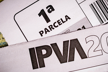 In this photo illustration the IPVA booklet (Property Tax for Motor Vehicles) seen on display.