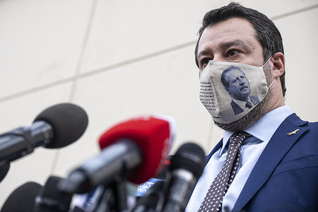 Matteo Salvini wearing a provocative mask with picture of anti-mafia prosecutor Paolo Borsellino who was killed in 1992 speaks to the media after the hearing. Matteo Salvini, former Interior Minister and leader of League Party, attends the preliminary hearing at the bunker room of Ucciardone Jail in Palermo, stands the accusation of kidnap and dereliction of duty, having denied the landing of Open Arms' rescue vessel about 150 people on board in August 2019. According to the court's decision, further documents need to be provided, so a postponement will be held on January (14th) and March (20th). In the aftermath of the court's decision, both representatives of the Spanish NGO Pro-Activa Open Arms and Salvini, with his lawyer Giulia Bongiorno, held a press release.