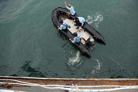 Indonesian Navy Divers, from navy ship KRI Gilimanuk, row their Rigid inflatable boat for rescue operation search of Sriwijaya Airlane flight SJ 182 that lost contact after taking off.  According to an airline spokesperson, contact to Sriwijaya Air flight SJ182 was lost on 09 January 2021 shortly after the aircraft took off from Jakarta International Airport while on route to Pontianak in West Kalimantan province. A search and rescue operation is under way.