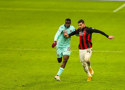 Theo Hernandez of AC Milan and Wilfried Singo of Torino FC are seen in action during the Serie A 2020/21 football match between AC Milan and Torino FC at the San Siro Stadium in Milan. (Final score; AC Milan 2:0 Torino FC)