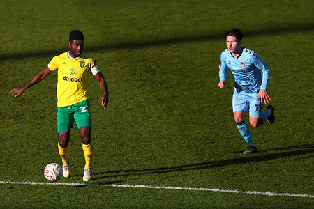 Alexander Tettey of Norwich City and Callum O'Hare of Coventry City in action during the FA Cup Third Round match between Norwich City and Coventry City at Carrow Road. Final Score; Norwich City 2:0 Coventry City.