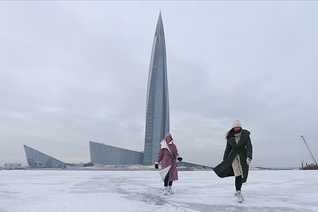 Ladies skate on the ice at the frozen Gulf of Finland with a background view of Lakhta Center in St. Petersburg. Temperatures dropped to minus eleven degree Celsius in the second capital of Russia.