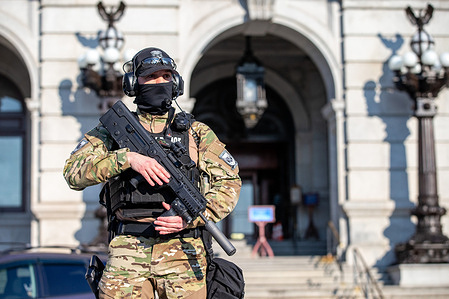 A member of the Pennsylvania Capitol Police Special Response Team stands outside the Pennsylvania State Capitol. An FBI bulletin warned that armed protests were being planned in all the 50 state capitols in the days leading up to President-elect Joe Biden's inauguration.