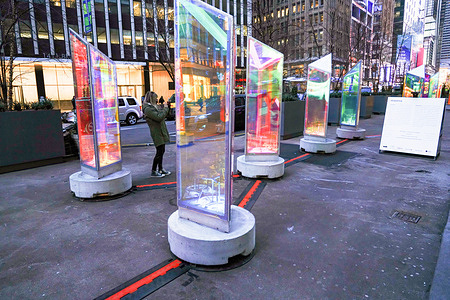 """A view of an art installation titled """"Prismatica"""" at the Garment District of New York. Prismatica is an immersive experience that engages your senses of sight and sound. The exhibition consists of 25 three-dimensional rotating prisms that emit iridescent colours and enchanting chime music into the atmosphere."""