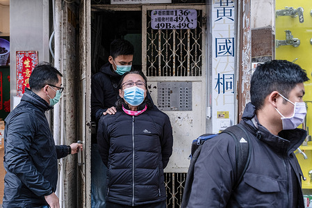 District Councillor and lawyer Daniel Wong Kwok-tung is escorted by police officers as he leaves his office. Wong was reportedly arrested by national security police officers for aiding twelve Hong Kong protesters in their bid to escape to Taiwan last August.