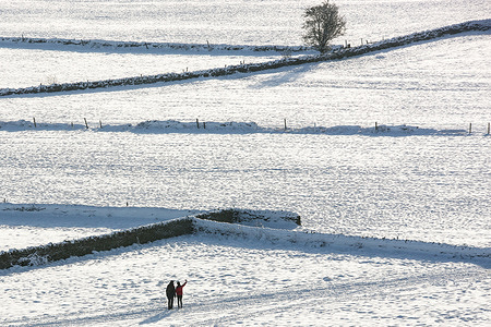 People stop for a photograph on snow-covered fields. Many parts of West Yorkshire are still covered with snow following heavy snowfall the previous day, which caused widespread disruption to travel.