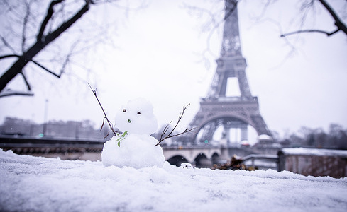 A snowman seen in front of the Eiffel Tower. Paris saw the first snow of the year as winter weather alerts were in place across much of central and northern France.