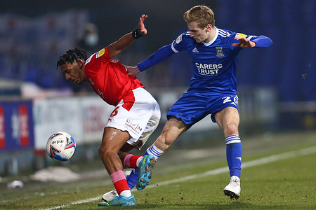Flynn Downes of Ipswich Town and Mathieu Baudry of Swindon Town in action during the Sky Bet League One match between Ipswich Town and Swindon Town at Portman Road. (Final Score: Ipswich Town 2 - 3 Swindon Town)