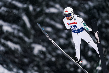 Yukiya Sato seen in action during the team competition of the FIS Ski Jumping World Cup.